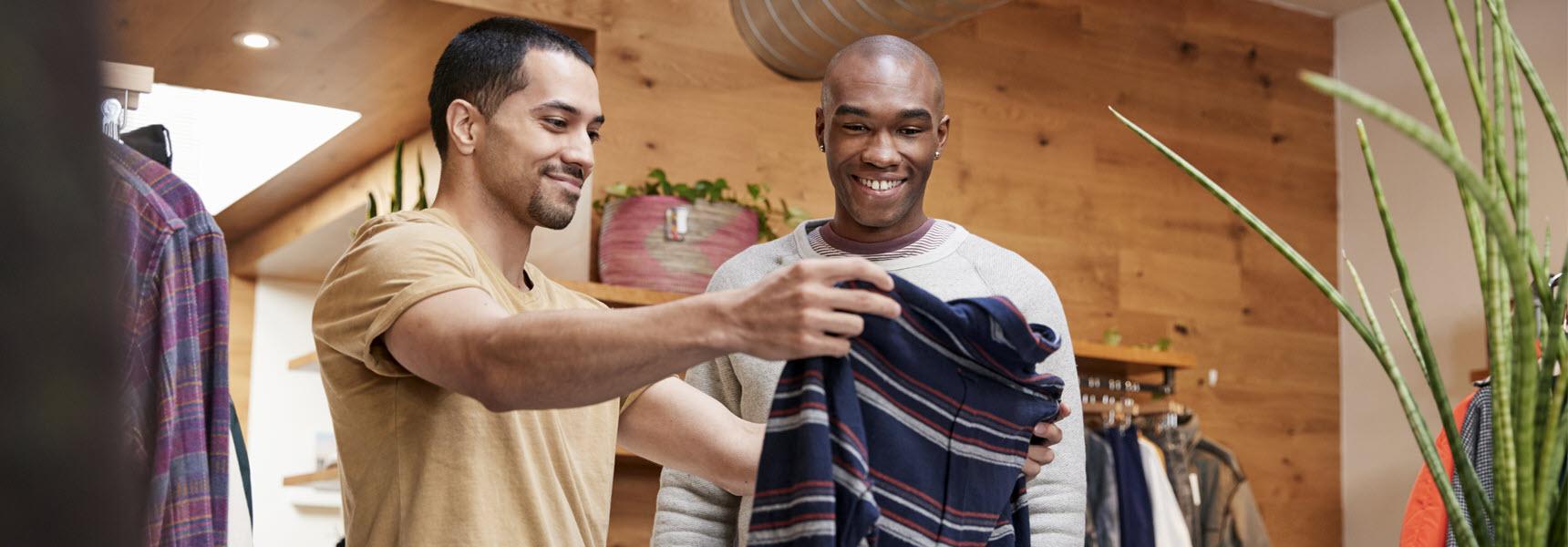 Two men splurging on new clothing.