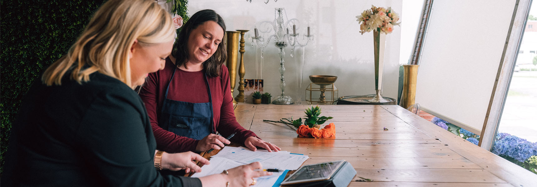 Photo of a woman talking with a financial professional.
