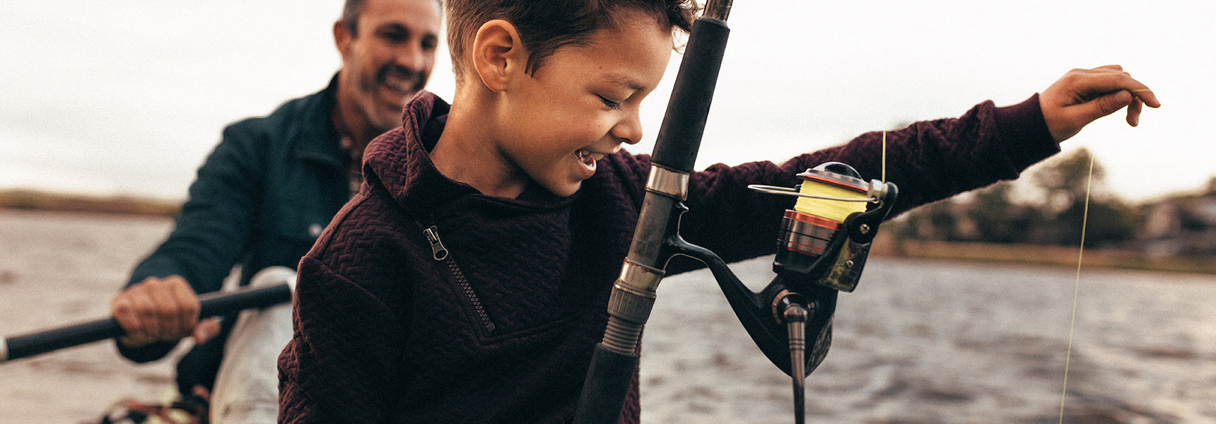 Father considers how a will and an estate plan might help care for the people he cares about as he kayaks with young son.