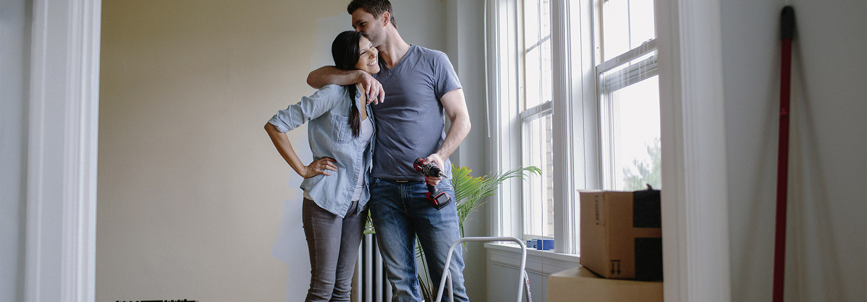 Photo of a couple budgeting for a home.