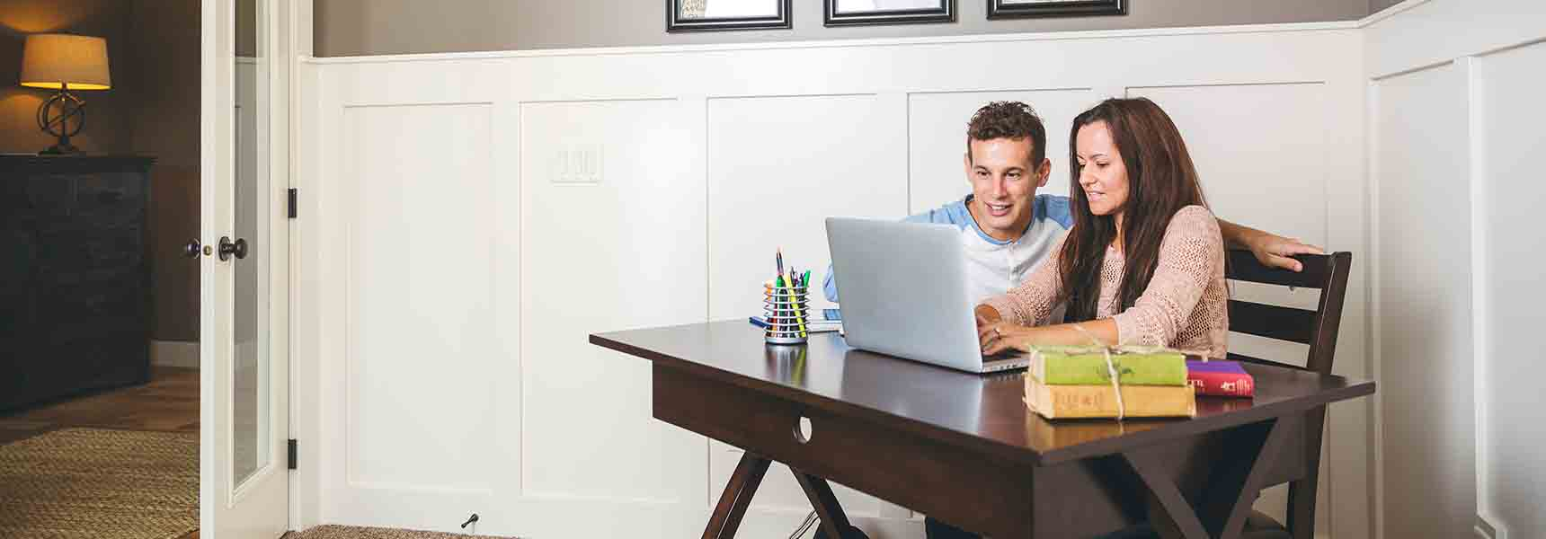 Photo of a couple learning about retirement planning through an online webinar.