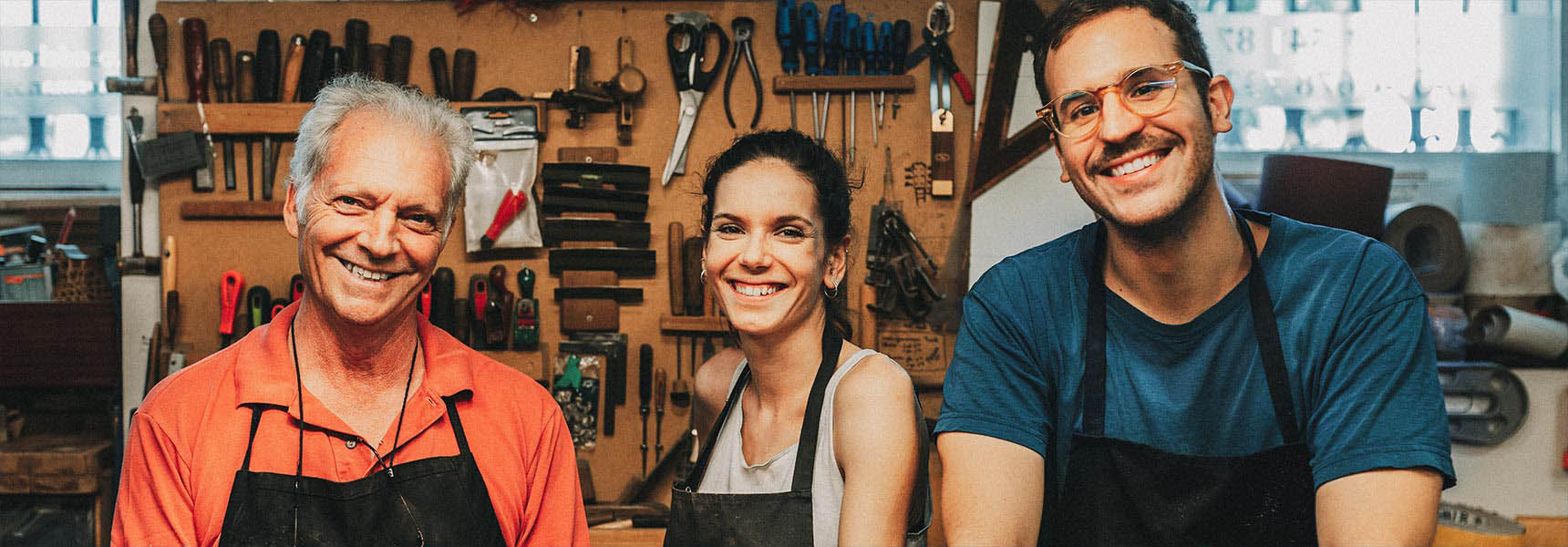 Photo of 3 employees in a workshop.