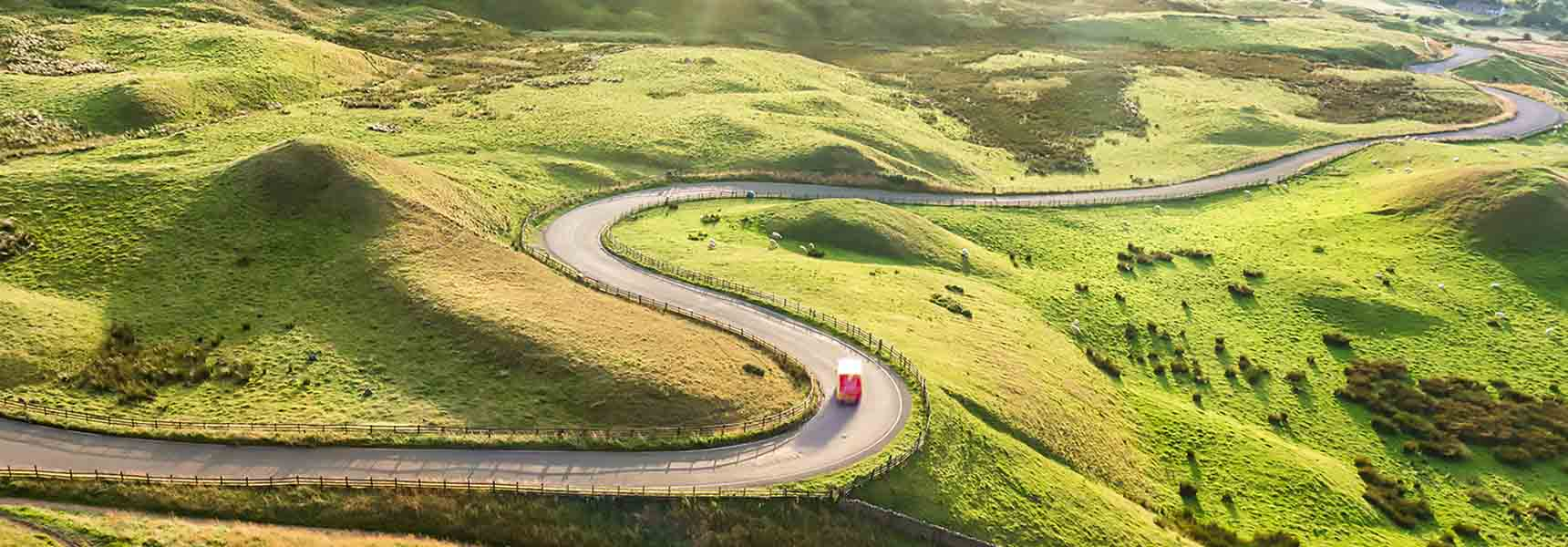 Photo of a winding road indicating the pattern of economic recessions.
