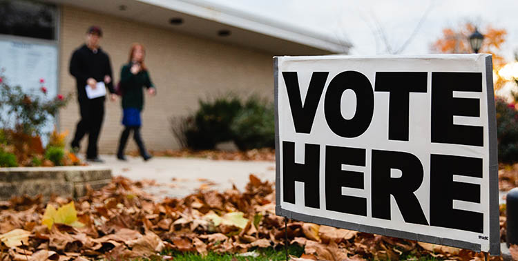 Photo of two people leaving a voting polling location.