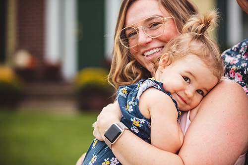 Photo of Ariana Schleisman holding her daughter Georgia.