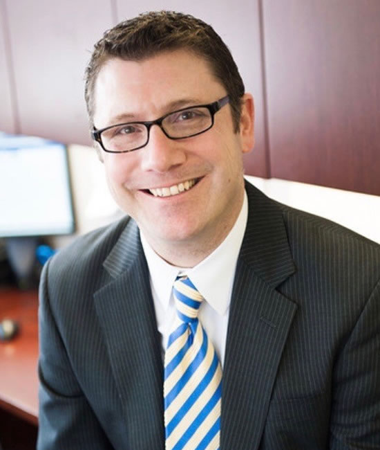 Photo of Elias Dau, Managing Director for the Southern California Business Center