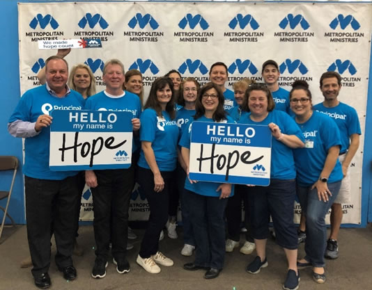 Photo of the Tampa office volunteering at Metropolitan Ministries