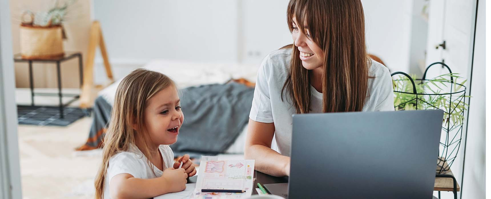 Photo of a young woman learning about retirement planning through an online webinar.