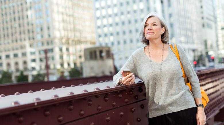 Woman thinking through steps she can take to safeguard her retirement savings, even when finances change.