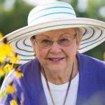 Photo of an older woman enjoying retirement.