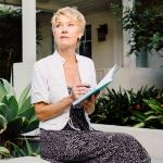 Woman learning about risks associated with retirement income and how to avoid them