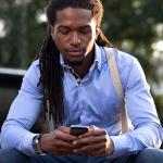 Man using technology to simplify his finances.