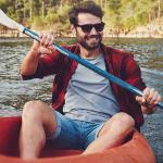 Man sitting in a kayak.