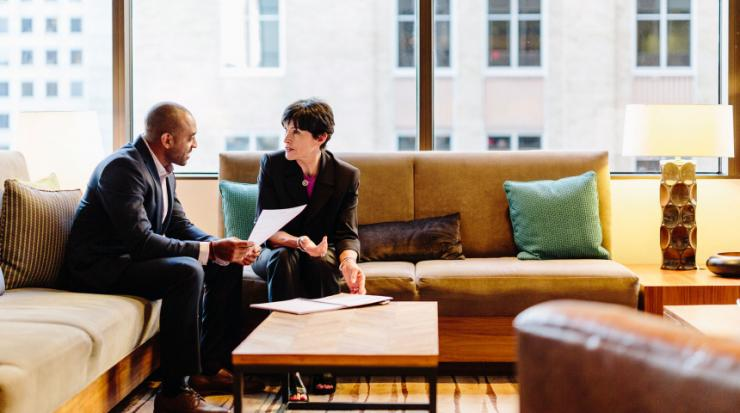 A financial professional reviewing a financial plan with her client.