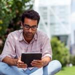 Man looking up information on retirement accounts to supplement his employer plan