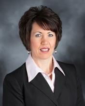 Photo of Becky Helle, Operations Manager of the Eastern Iowa Business Center.