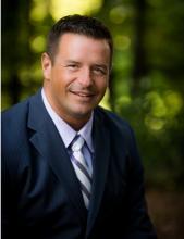 Photo of John Hoffman, Regional Managing Director of the Minnesota Business Center.