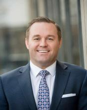 Photo of Justin Piprude, Managing Director of the Minnesota Business Center.