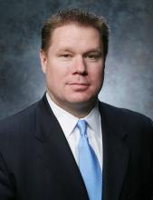 Photo of Thomas O'Grady, Regional Managing Director of the Illinois Business Center.