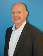 Photo of Todd Vroman, Managing Director of the New England Business Center.