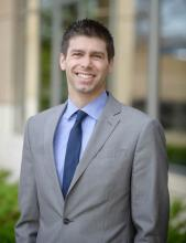 Photo of Zach Wood, Development Director of the Minnesota Business Center.