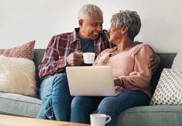 Photo of a couple talking about whether they should retire together.