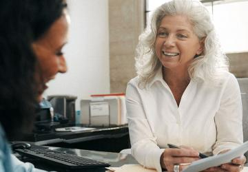 Photo of a woman meeting with a financial professional.