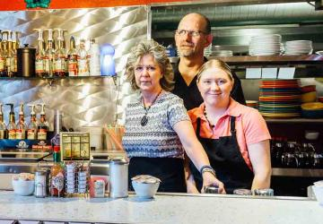 Photo of a family working in their family-owned restaurant.