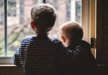 Photo of children how are protected by a life insurance policy.