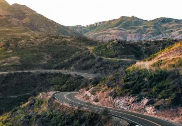 Photo of a road winding through hills.
