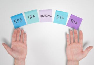 Image showing investment acronyms EPS, IRA, Nasdaq, ETF, and RIA.
