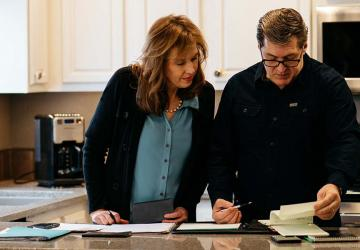 Mark and Kelly Timmerman who through their meticulous budgeting have been able to retire early.