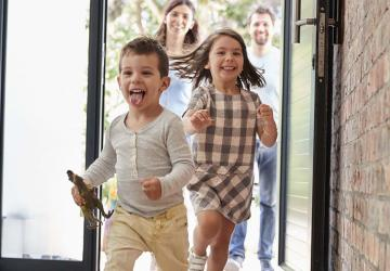 Photo of a family who is happy to be protected by life insurance through their employer.