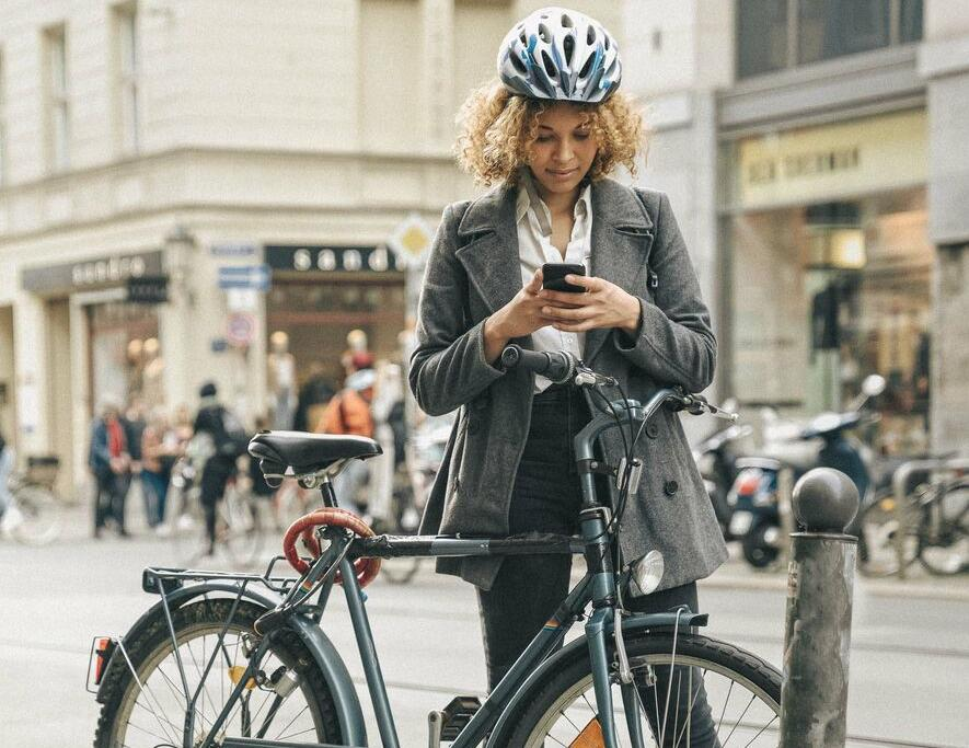 Photo of a woman with a bike.